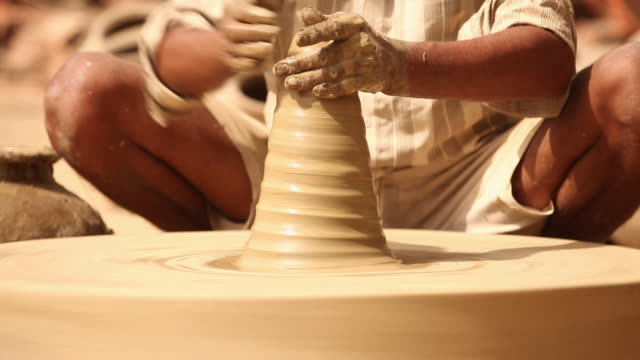 man making a earthen pot on a pottery wheel, faridabad, haryana, india - potter's wheel stock videos & royalty-free footage