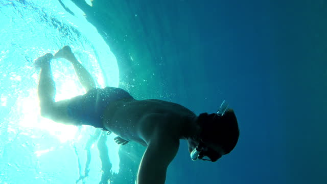 pov man making a flip turn in the sea - snorkelling stock videos & royalty-free footage