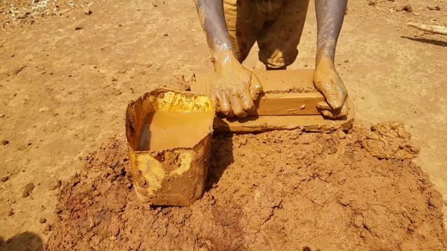 man making bricks in an old fashion way in africa - brick stock videos & royalty-free footage