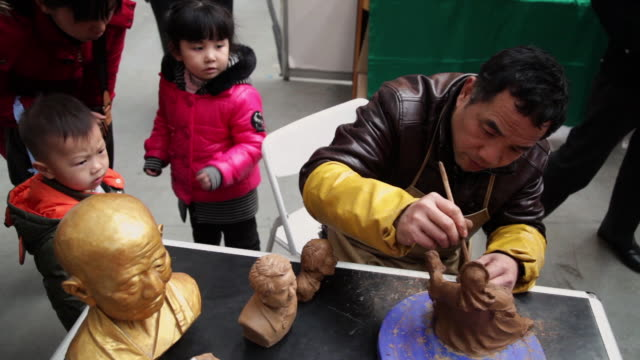 ms man making clay figure souvenirs / xi'an, shaanxi, china - clay stock videos & royalty-free footage
