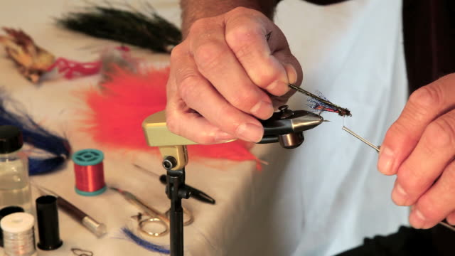 man making fishing lures - hook stock videos and b-roll footage
