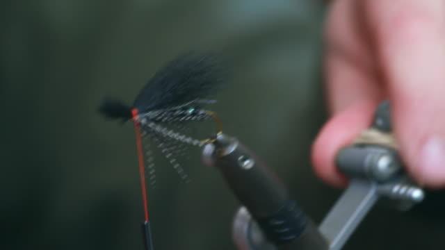 CU Man making fly fishing lure / Devon, England, United Kingdom