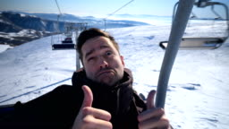 Man making funny faces on ski lift