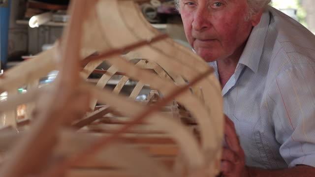 man making model boat