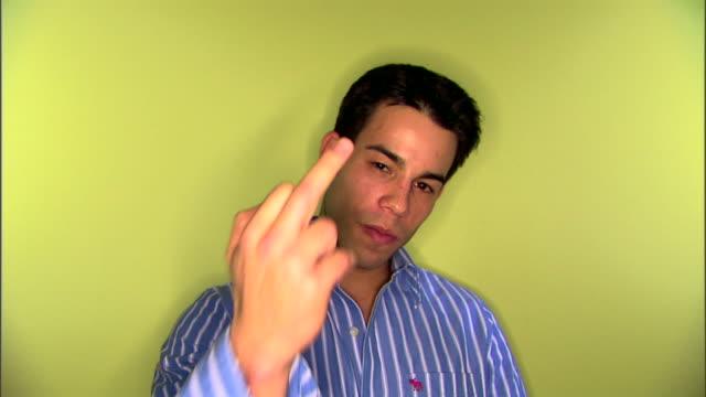 man making obscene gesture - obscene gesture stock videos and b-roll footage