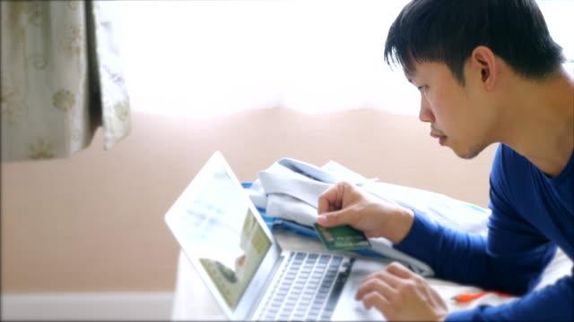 Man making online purchase using laptop computer