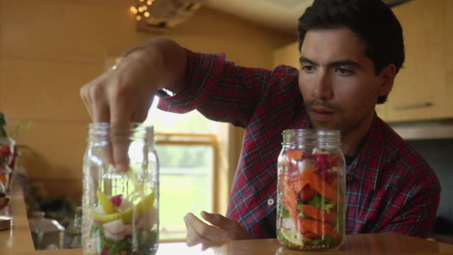 MS Man making pickles in kitchen, Bovina Center, New York, USA