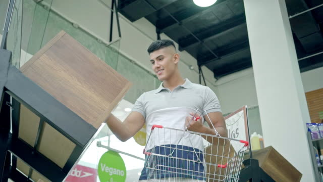 man making purchases in the supermarket - shopping basket stock videos and b-roll footage