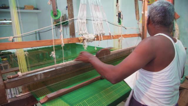 man making sari, indian clothing, using traditional loom - sari stock videos & royalty-free footage