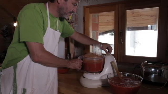 man making tomato sauce, cooking
