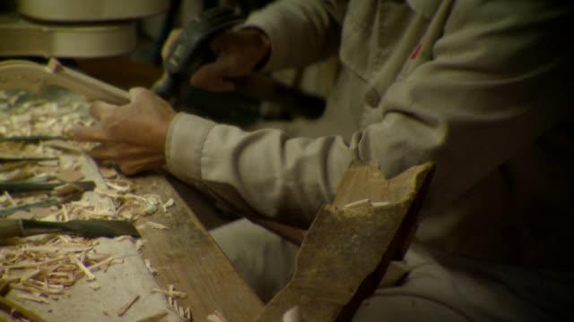 cu man making violin in factory, mid section, taizhou-taixing factory, taizhou, jiangsu, china - violin stock videos & royalty-free footage