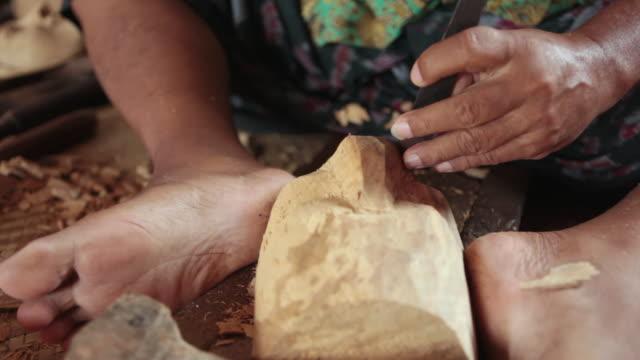 CU Man making wooden mask / Mas, Bali/Gianyar/Ubud, Indonesia