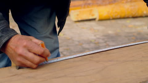 man measures and marks section of wood - tape measure stock videos & royalty-free footage
