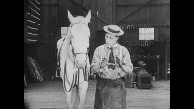1922 man (buster keaton) measures horse for horseshoe - saddle stock videos & royalty-free footage