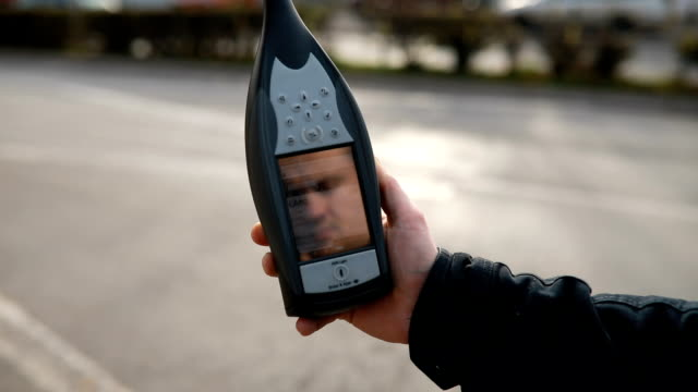 man measuring sound pollution with decibel meter - accuracy stock videos & royalty-free footage