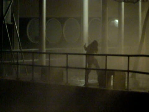 Man measuring wind speed lashed by spray, Typhoon Koppu, Hong Kong on night of 14th sept 2009. With Audio.