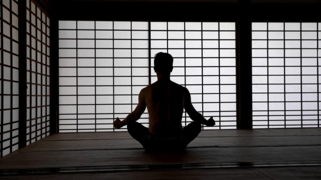 ds man meditating in tatami house - cross legged stock videos & royalty-free footage