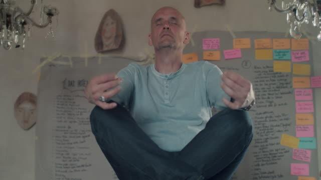 Man meditating on table