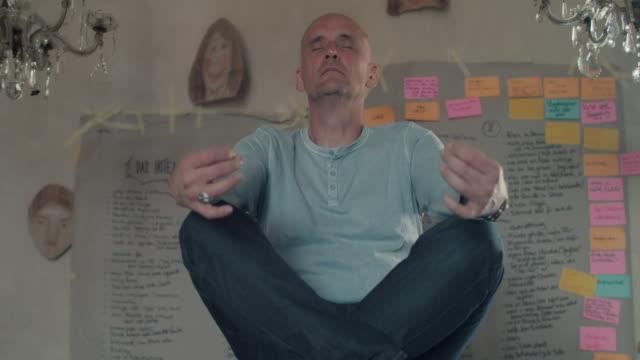 Man meditating on table