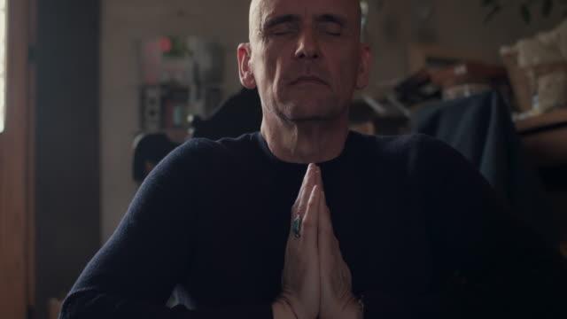 man meditating/practicing yoga - breathing exercise stock videos & royalty-free footage