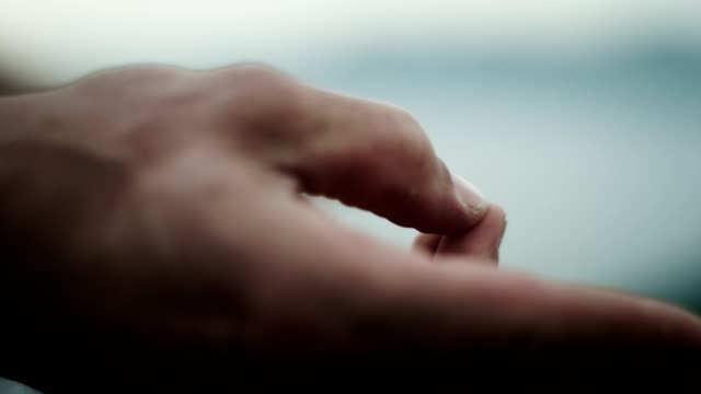 man meditation. close up on hands. rocky coastline - mudra stock videos & royalty-free footage
