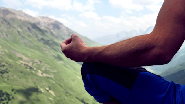 man meditation. high mountains range - mountain pose stock videos and b-roll footage