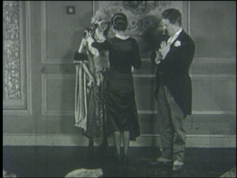 B/W 1920 man (Billy Bevan) mistakes woman for mannequin, lifts her dress, she slaps him