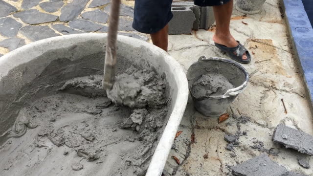 Man mixing a cement in salver for applying construction