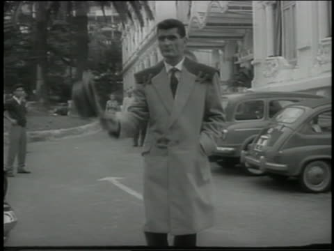 b/w 1959 man modeling overcoat in parking lot / italy - fashion model stock videos & royalty-free footage