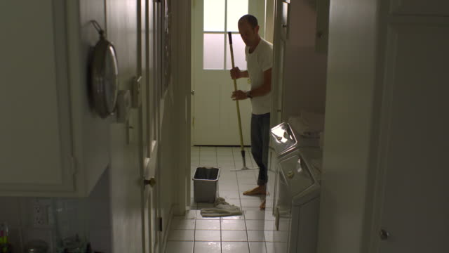 ws, man mopping tile floor in laundry room, hollywood, california, usa - flooring stock videos & royalty-free footage