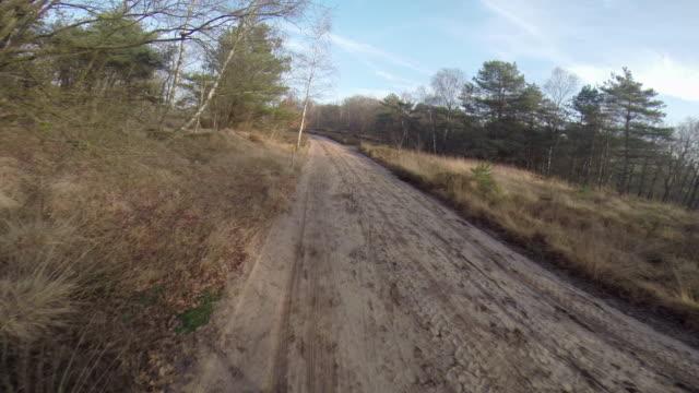 a man mountain biking.  - サイクリングロード点の映像素材/bロール