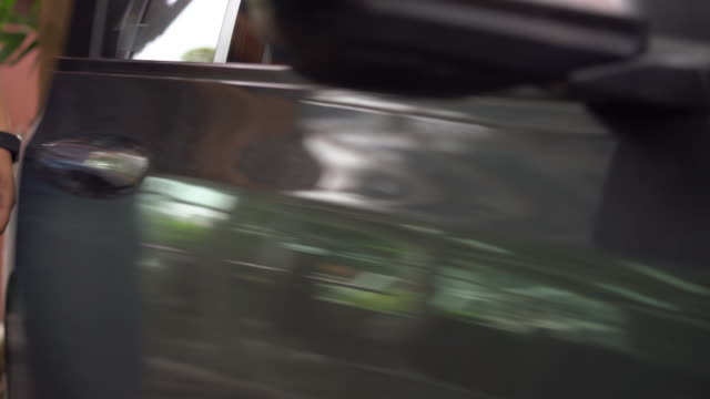 man move out the car door and locked car door. - chauffeur stock videos and b-roll footage
