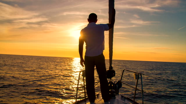 ls man observing the horizon from a boat - yacht stock videos & royalty-free footage