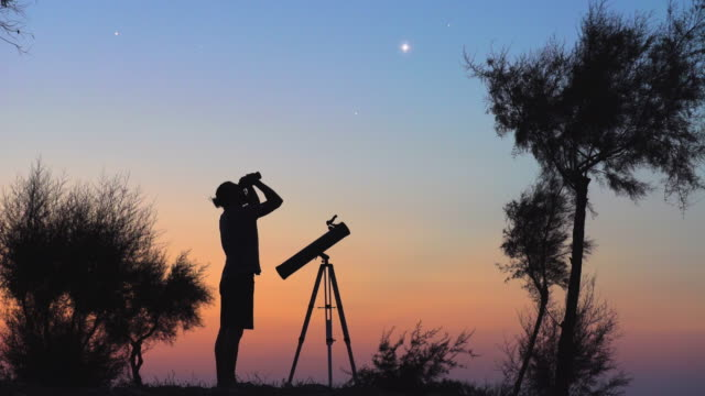 A man observing the night sky