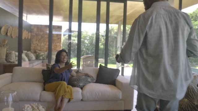 man offering wine to woman at home - wineglass stock videos & royalty-free footage