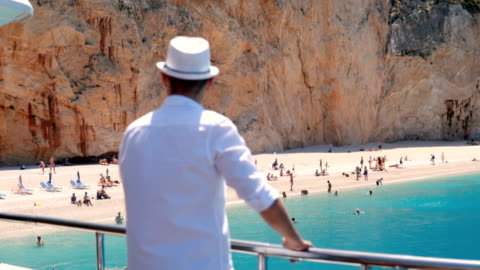 stockvideo's en b-roll-footage met man op het dek van een boot - griekenland