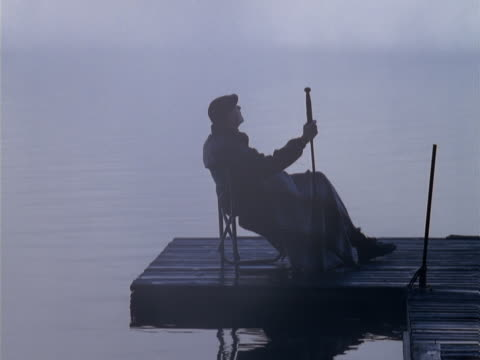 man on a foggy dock - one senior man only stock videos & royalty-free footage