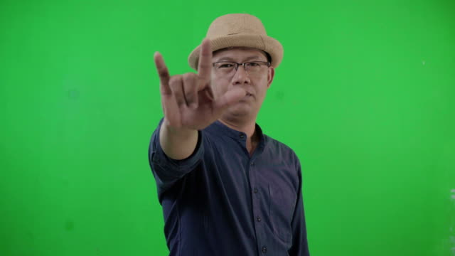 man on a green screen raise your hand to make a promise. - i love you stock videos & royalty-free footage