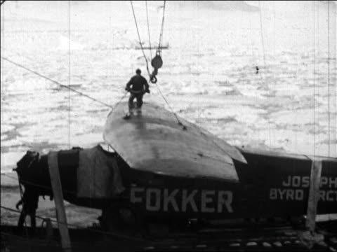 b/w 1926 man on airplane wing on fuselage of plane for byrd's flight over the north pole / newsreel - 1926 stock videos & royalty-free footage