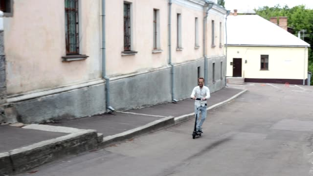 A man on an electric scooter.