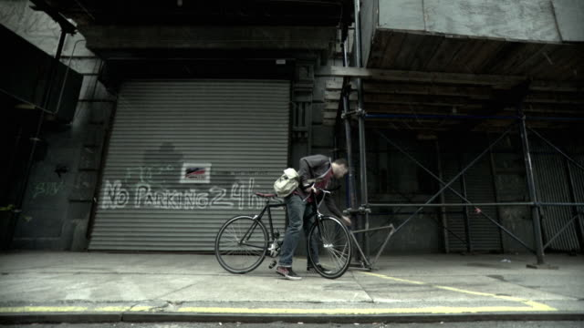 ms la man on bicycle picking up abandoned bicycle frame from sidewalk, brooklyn, new york city, new york state, usa - bicycle frame stock videos & royalty-free footage