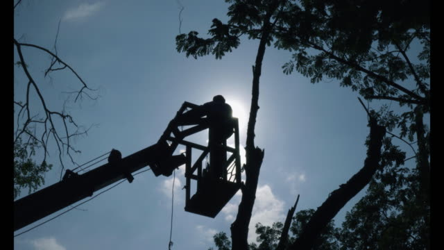 man on boom truck basket 4k. - bucket stock videos & royalty-free footage