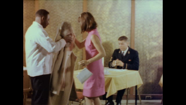 / man on date walks through door and lets it close on his date / man leads the way to the dining area as woman walks behind him frustrated / waiter... - speisezimmer stock-videos und b-roll-filmmaterial