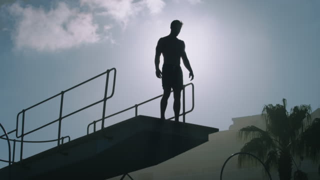man on diving board - diving platform stock videos and b-roll footage