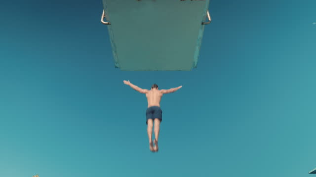 man on diving board - diving into water stock videos & royalty-free footage