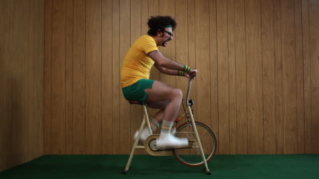 WS Man on exercise bike, Atlanta, Georgia, USA