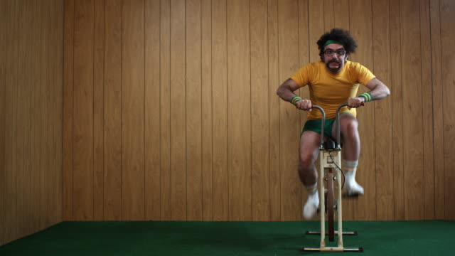 ws man on exercise bike, atlanta, georgia, usa - slapstick stock-videos und b-roll-filmmaterial