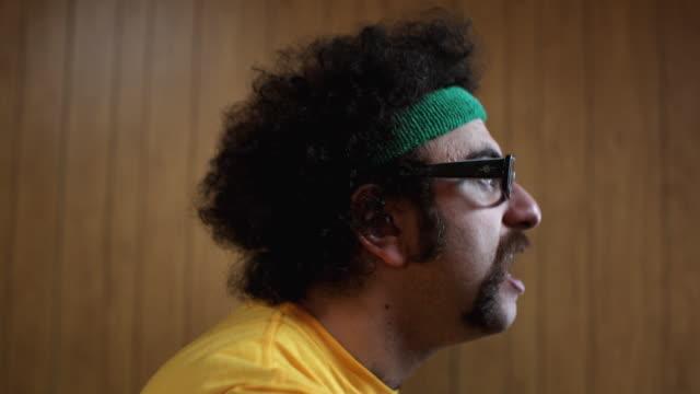 cu man on exercise bike making faces, atlanta, georgia, usa - casual clothing stock videos & royalty-free footage