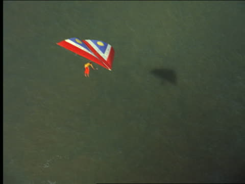 aerial man on hang gliding over ocean - hang gliding stock videos and b-roll footage