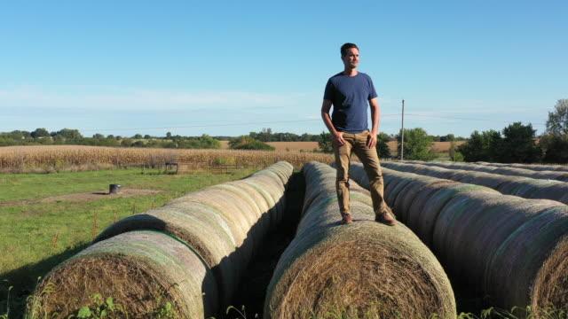 man on hay bales - waving stock videos & royalty-free footage